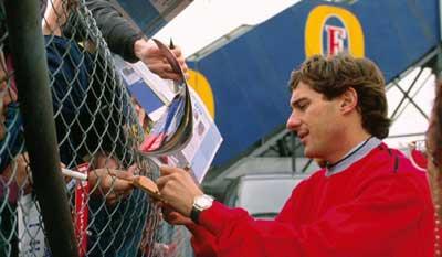 Ayrton Senna signs autographs
